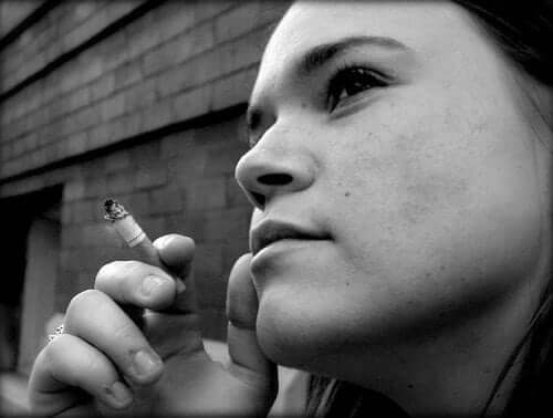 She gave up smoking long ago, but she'll sneak a cigarette when you're out