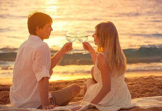 Honeymoon concept, Man and Woman in love, Couple enjoying glass